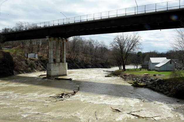 The waters are moving under the Delaware Avenue Bridge Tuesday afternoon April 21, 2015, on the Normans Kill in Albany, N.Y.  (Skip Dickstein/Times Union) Photo: SKIP DICKSTEIN / 00031544A