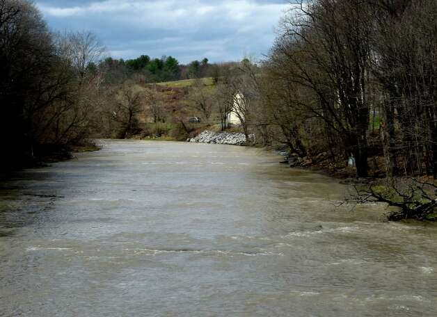 The waters are moving Tuesday afternoon April 21, 2015, on the Normans Kill in Albany, N.Y.  (Skip Dickstein/Times Union) Photo: SKIP DICKSTEIN / 00031544A