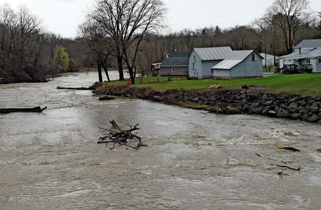 The waters are moving under the Delaware Avenue Bridge Tuesday afternoon April 21, 2015, on the Normanskill Creek in Albany, N.Y.  (Skip Dickstein/Times Union) Photo: SKIP DICKSTEIN / 00031544A