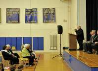 Father Jim Spenard, pastor of St. Augustine School leads students and guests in prayer during a dedication ceremony at St. Augustine School on Tuesday, April 21, 2015, in Troy, N.Y.  The St. Augustine Early Childhood Center will be re-named the Kelly T. Sanvidge Catholic Childhood Center, for his donation of $250,000.  St. Augustine school was founded in 1869.  (Paul Buckowski / Times Union)