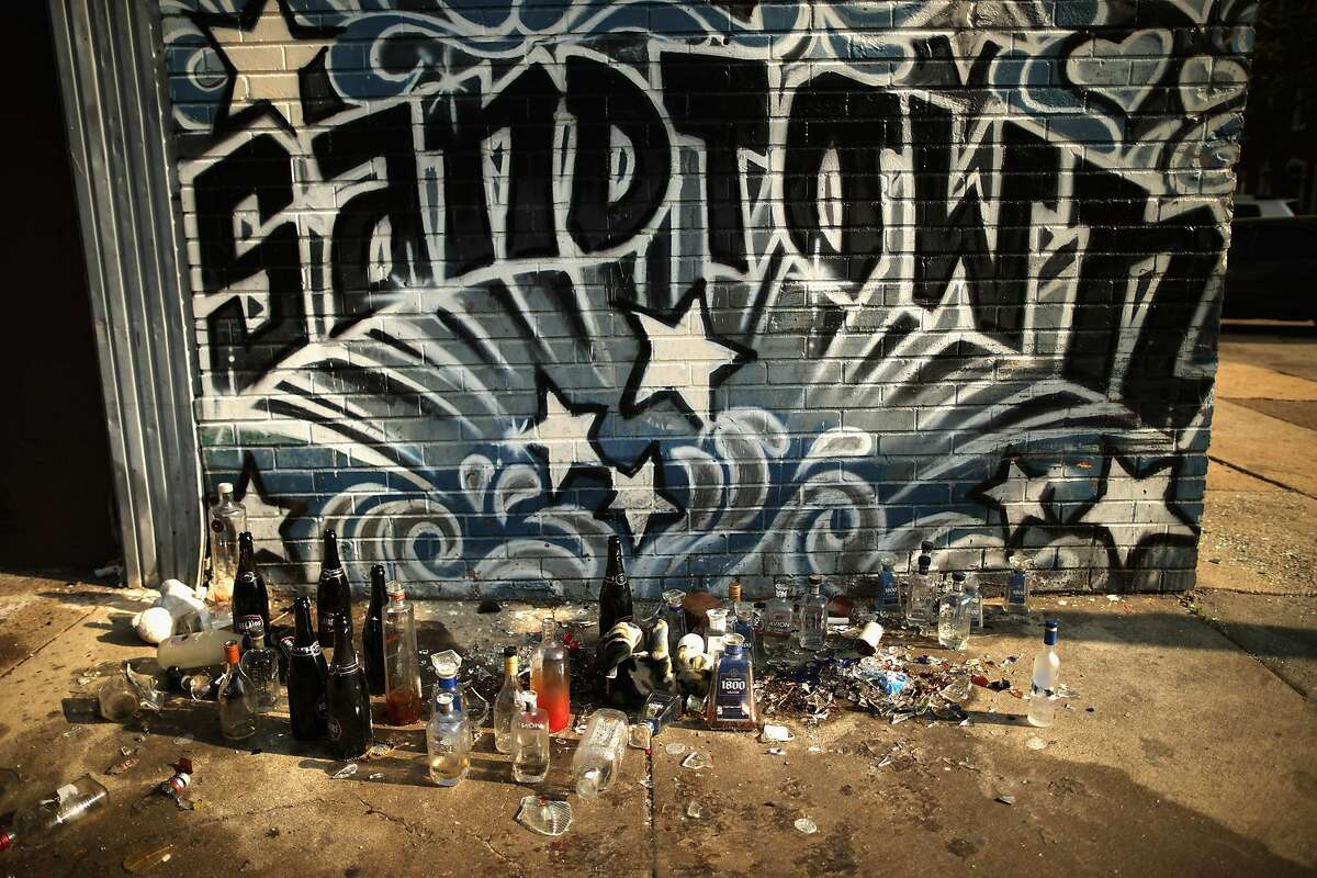 BALTIMORE, MD - APRIL 21: A pile of empty and smashed liquor, beer and champagne bottles form an informal memorial around the corner from the Baltimore Police Western District station where Freddie Gray was taken after being arrested in the Sandtown neighborhood April 21, 2015 in Baltimore, Maryland. Gray, whose nickname was Pepper, was a 25-year-old black man who lived in this neighborhood and was arrested for possessing a switch blade knife April 12 outside the Gilmor Homes housing project on Baltimore's west side. According to his attorney, Gray died a week later in the hospital from a severe spinal cord injury he received while in police custody. (Photo by Chip Somodevilla/Getty Images)
