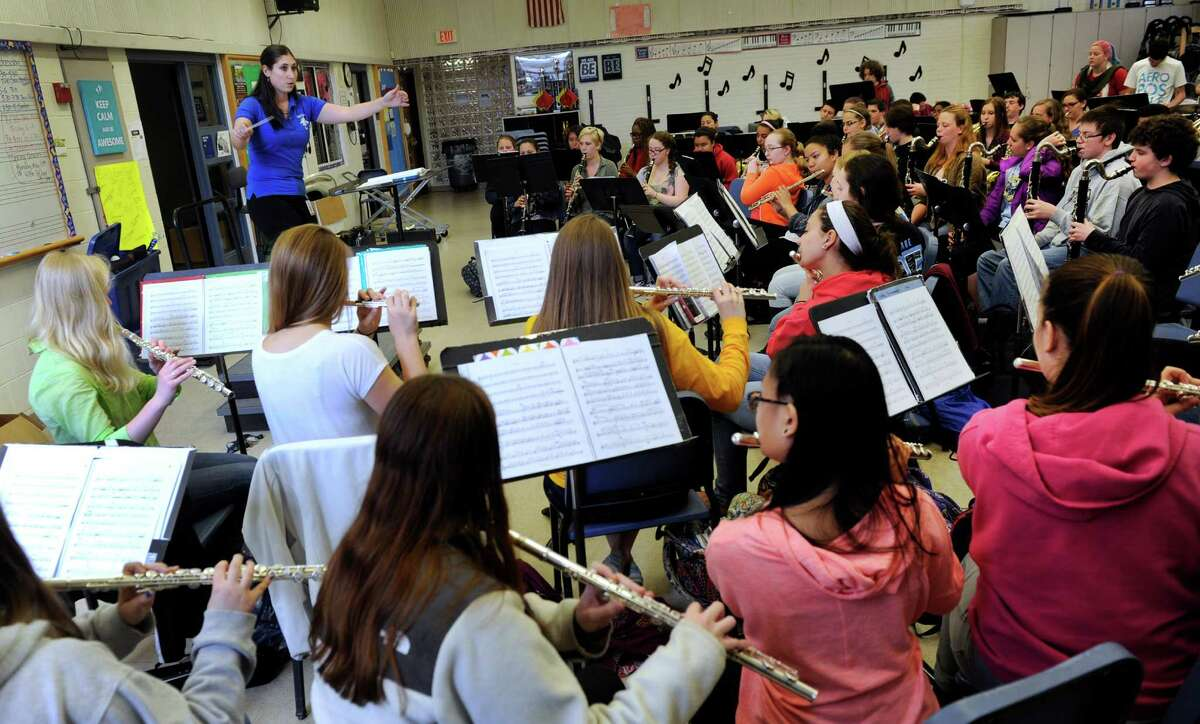 Bristol Public Schools Pictured: Amy Dauphinais, 29, a Danbury, Conn. native, is the director of bands and music teacher at Bristol Eastern High School in Bristol, Conn.. She is photographed leading a band rehearsal at the school Tuesday, April 21, 2015.
