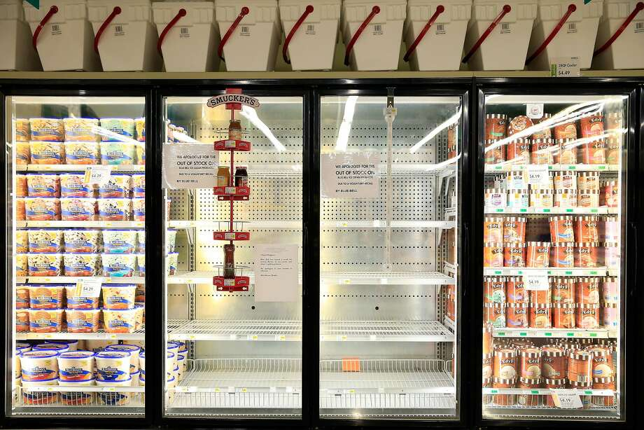 Shelves are bare and signs are posted in Overland Park, Kan., where Blue Bell products were displayed in a grocery store. Blue Bell Creameries recalled all products following a Listeria contamination. Photo: Jamie Squire, Getty Images
