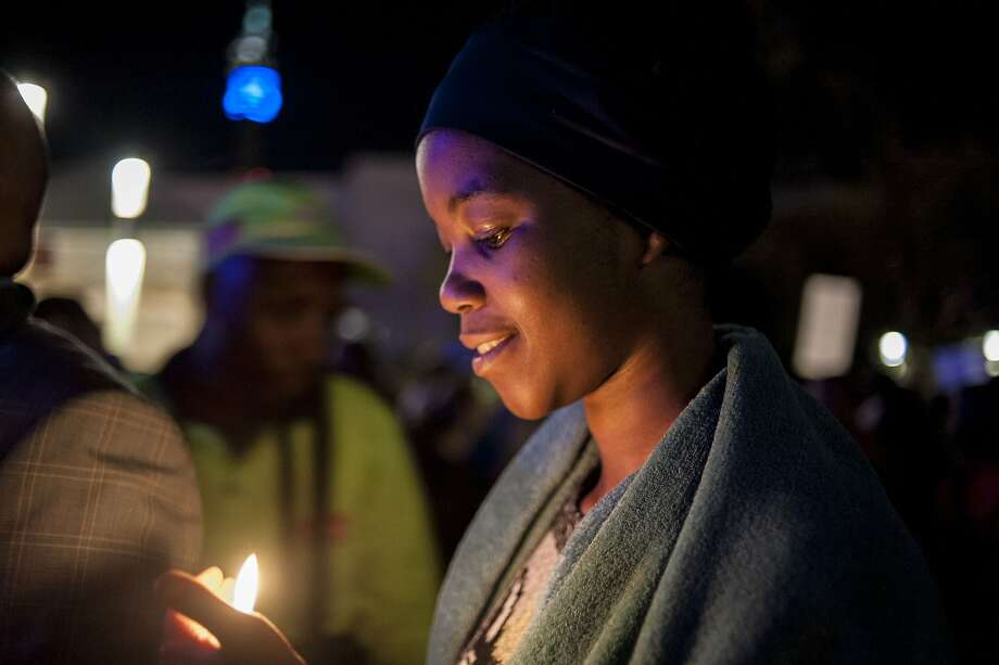 A silent candlelight vigil against xenophobia is  held at Constitution Hill in Johannesburg. Photo: Stefan Heunis, AFP / Getty Images