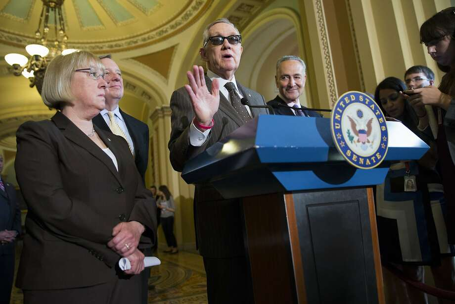 Harry Reid and fellow Democratic Sens. Patty Murray, Dick Durbin and Chuck Schumer talk about their deal with Republicans on a human-trafficking bill. Photo: Evan Vucci, Associated Press