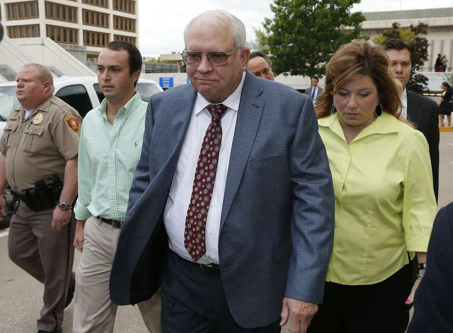 Robert Bates (second from right) leaves his arraignment in Tulsa, Okla. Photo: Sue Ogrocki, Associated Press