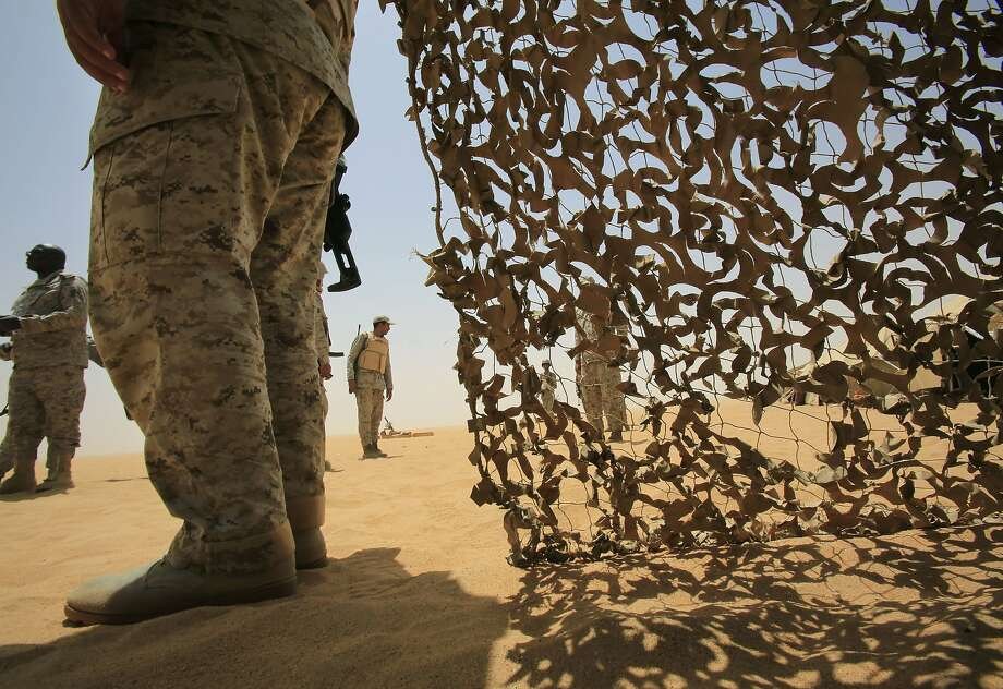 Saudi soldiers stand alert at the border with Yemen in Najran, Saudi Arabia, Tuesday, April 21, 2015. (AP Photo/Hasan Jamali) Photo: Hasan Jamali, Associated Press
