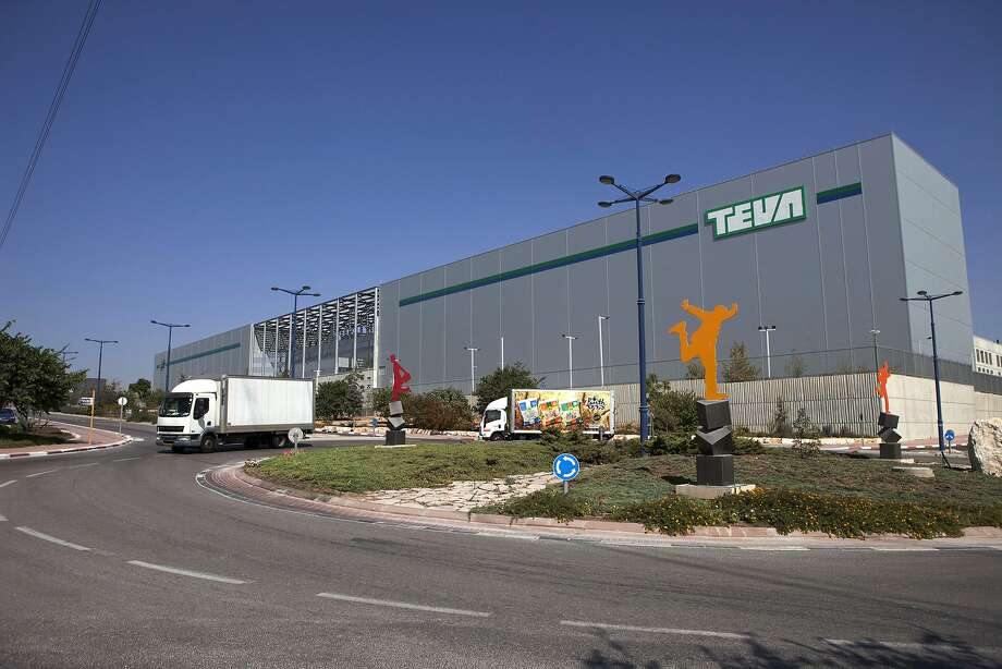 FILE - In this Oct. 16, 2013 file photo, trucks run past Teva Pharmaceutical Logistic Center in the town of Shoam, Israel. On Tuesday, April 21, 2015, Teva has offered to buy Mylan for about $40.1 billion in cash and stock in a deal that would create a powerhouse of generic drug development.  (AP Photo/Dan Balilty, File) Photo: Dan Balilty, Associated Press