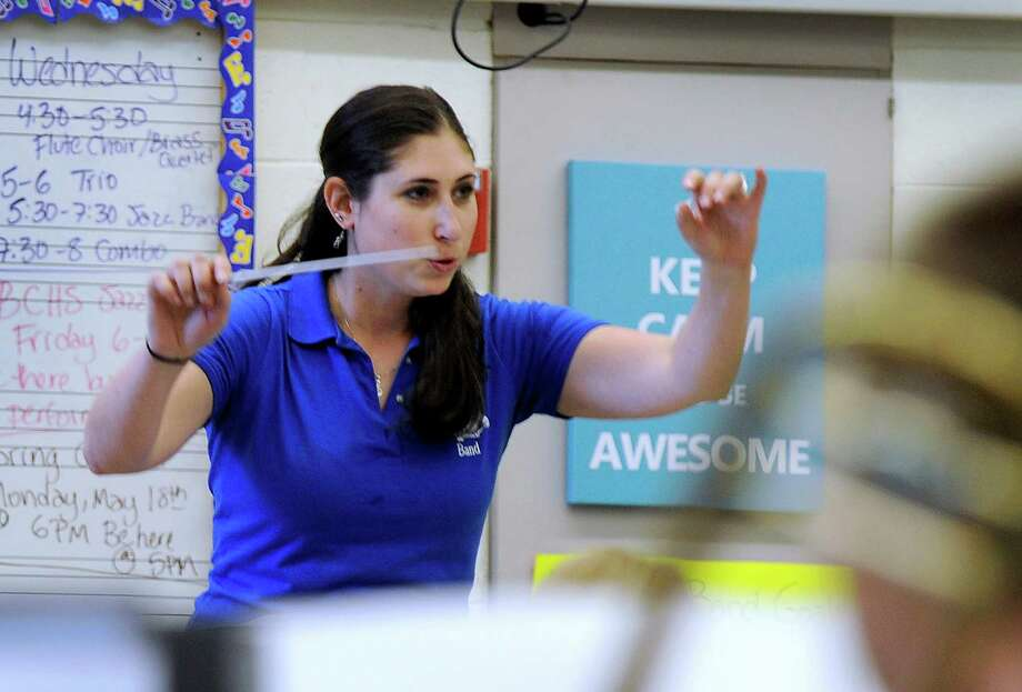 Amy Bovin Dauphinais, 29, a Danbury, Conn. native, is the director of bands and music teacher at Bristol Eastern High School in Bristol, Conn.. She is photographed leading a band rehearsal at the school Tuesday, April 21, 2015. Photo: Carol Kaliff / The News-Times