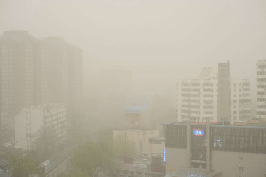 BEIJING, CHINA - APRIL 15: (CHINA OUT) Heavy sand and dust float in the air on April 15, 2015 in Beijing, China. Heavy sand and dust enveloped the whole capital of China and its neighbouring Hebei province also showed strong wind and dusty weather. (Photo by ChinaFotoPress/ChinaFotoPress via Getty Images) Photo: ChinaFotoPress, Getty Images