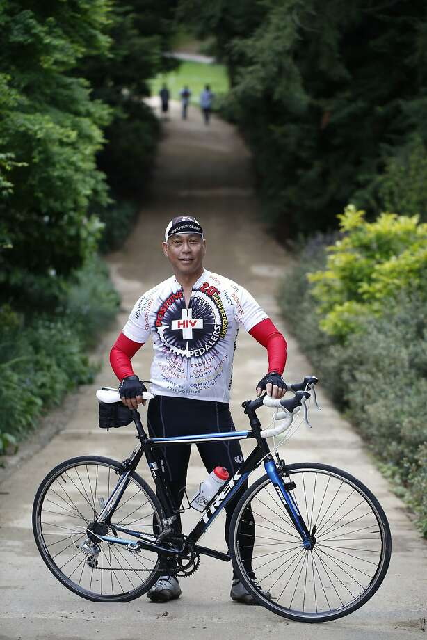 """HIV advocate and cyclist with Positive Pedalers, a group of HIV-positive men who participate in AIDS/LifeCycle every year, Greg Mahusay, 54, stands with his bike near the AIDS memorial grove in Golden Gate Park on Monday April 20, 2015 in San Francisco, Calif.  Mahusay, who has been HIV positive since 1989,  is part of an upcoming installation called """"The Graying of AIDS."""" Photo: Mike Kepka, The Chronicle"""