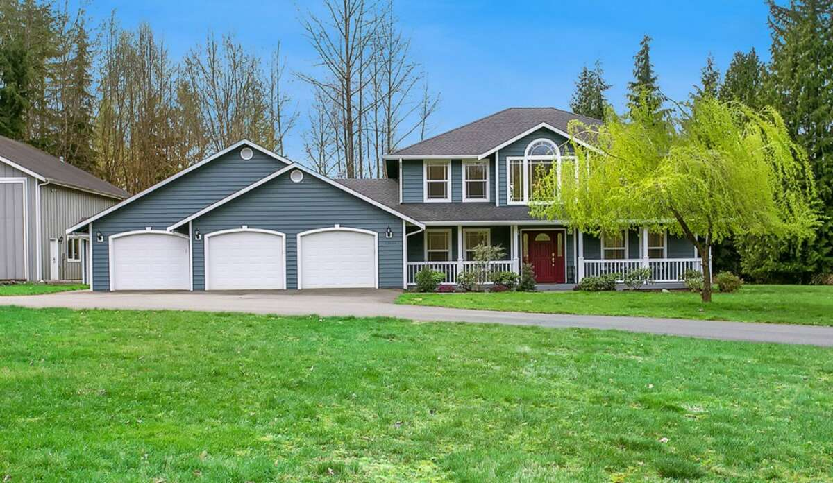 This home, 12904 128th Ave. N.E., is notable for its large garage with loft area. It is located in the gated Frontier Air Park neighborhood in Lake Stevens. The four bedroom, three-and-one-quarter bathroom home is listed for $624,950. See the full listing here.