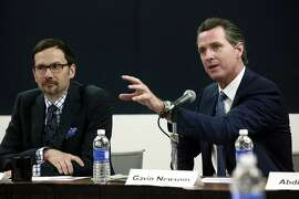 California Lt. Gov. Gavin Newsom, right, speaks during a public forum on his Blue Ribbon Commission on Marijuana Policy at UCLA, Tuesday, April 21, 2015, in Los Angeles. At left is David Ball, associate professor at Santa Clara University School of Law. Newsom, a Democrat who supports legalization, said it's time for the state to move in a new direction but raised concerns about the threat of a black market if taxes drive buyers underground. (AP Photo/Nick Ut)