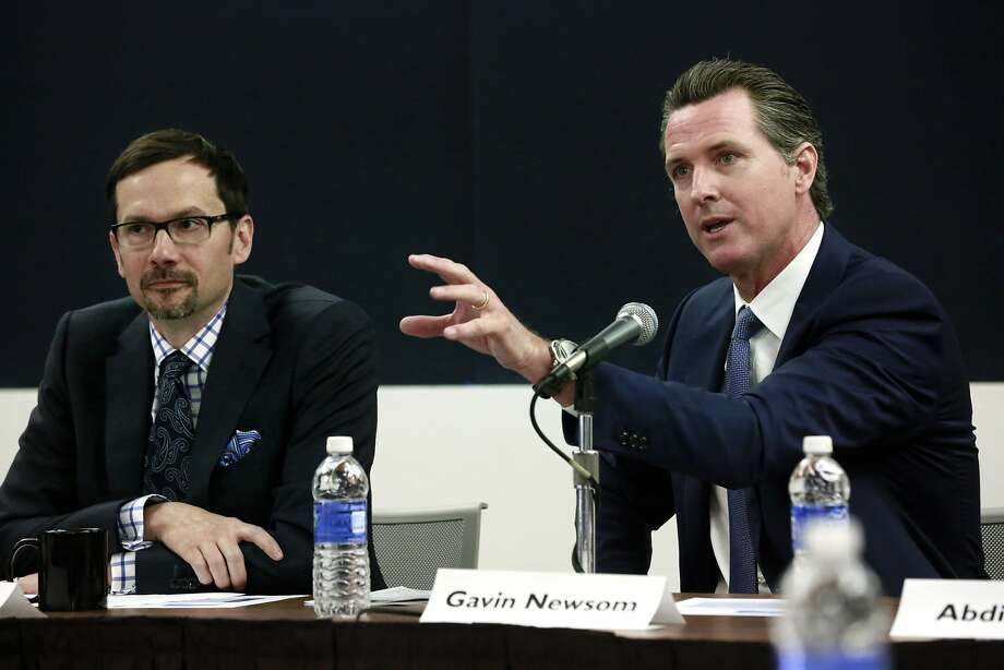 Lt. Gov. Gavin Newsom (right) leads a public forum of his marijuana policy commission at UCLA. David Ball (left) is an associate professor at Santa Clara University School of Law who supports legalization. Photo: Nick Ut, Associated Press