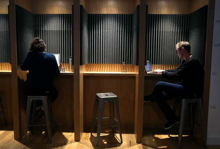 People work in booths designed to minimize noise at the General Assembly campus on Bush Street in San Francisco, Calif. on Tuesday, April 21, 2015.