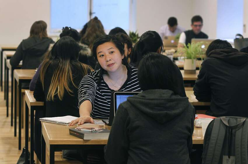 Students and others relax in a lunch area at the General Assembly campus on Bush Street in San Francisco, Calif. on Tuesday, April 21, 2015.