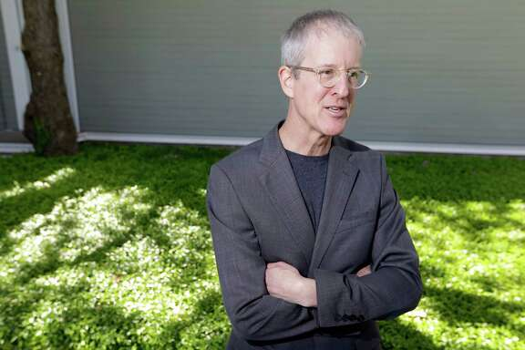 """Urban planner and author Jeff Speck poses outside the Menil Collection, 1533 Sul Ross, Tuesday, April 21, 2015, in Houston. He gave a speech to a group at the Menil Collection called """"Towards a More Walkable Houston.""""  ( Melissa Phillip / Houston Chronicle )"""
