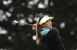 Michelle Wie hits a six irons to the par-3 fifthteenth hole during a practice round for the Swinging Skirts LPGA Classic golf tournament at Lake Merced Golf Course, in San Francisco, Calif., on Tues. April 21, 2015.