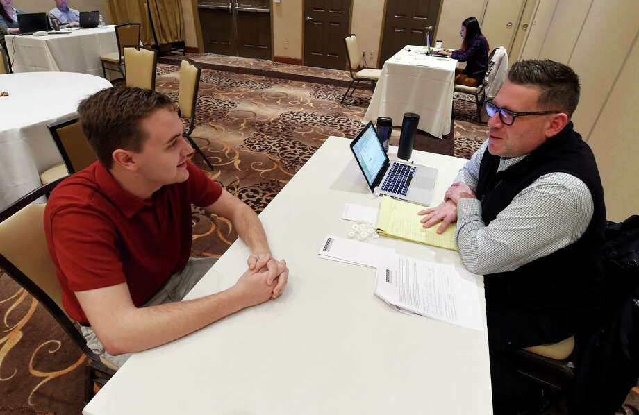 Valentine Federico-Maietta, left is interviewed by Adam Foti, culinary assistant /event chef during the Mazzone Hospitality job fair  Monday morning April 20, 2015 at the Hilton Garden Inn in Clifton Park, N.Y.  Mazzone was looking for qualified workers in all of their divisions.     (Skip Dickstein/Times Union) Photo: SKIP DICKSTEIN / 00031531A