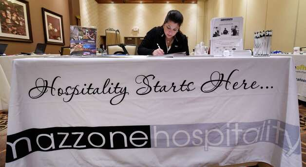 Danielle Mancuso takes notes during the Mazzone Hospitality job fair Monday morning April 20, 2015 at the Hilton Garden Inn in Clifton Park, N.Y.  Mazzone was looking for qualified workers in all of their divisions.     (Skip Dickstein/Times Union) Photo: SKIP DICKSTEIN / 00031531A