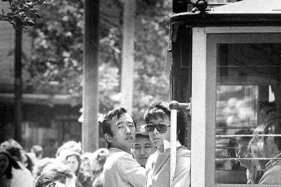 Tourists visit San Francisco Japanese tourists take pictures at cable car  Photo taken 06/09/1977 Photo ran 09/16/1984, pg. 6