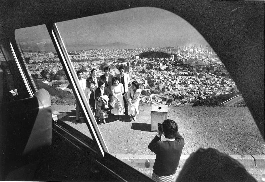 Tourists on a bus tour, take pictures of the San Francisco skyline from Twin Peaks   Photo ran 04/18/1977 Photo: Gary Fong, The Chronicle