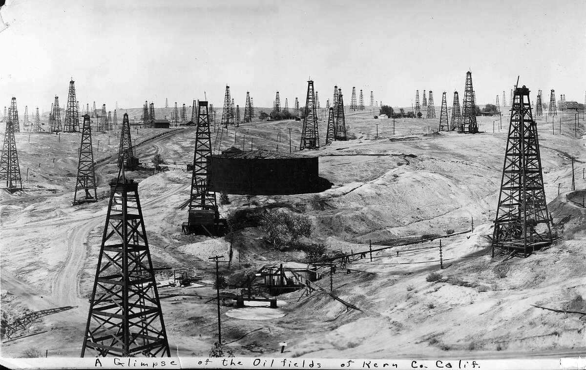 Derricks crowd the Kern River oil field in 1912 in Bakersfield, Calif. High oil prices have allowed Chevron Corp. to squeeze more oil out of the aging oil field, which has already produced more than 2 billion barrels of crude. Photo courtesy of Chevron