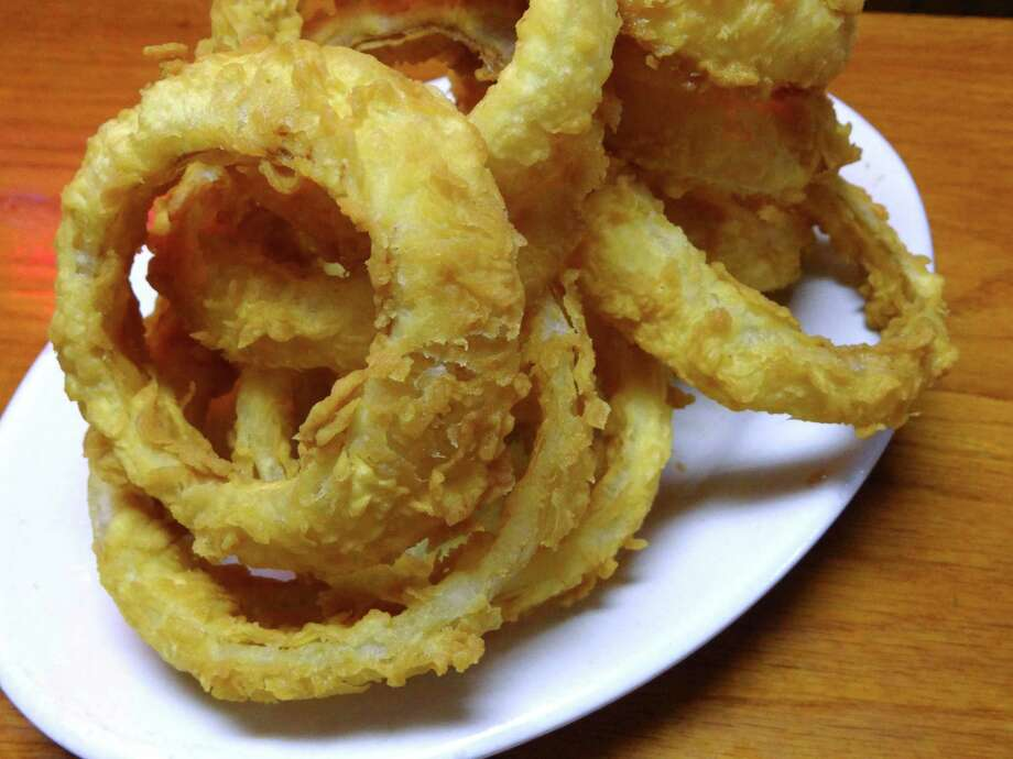 Tip Top Cafe's onion rings are a meal in themselves. Photo: Billy Calzada /San Antonio Express-News / ¨ 2012 San Antonio Express-News