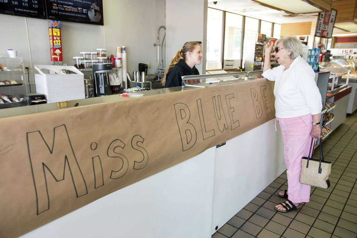"""Marian Fleming, of Austin, talks to Elizabeth Neumann, after Fleming was disappointed to find no Blue Bell ice cream available at Scoops! ice cream shop on Tuesday, April 21, 2015, in Brenham. Blue Bell Creameries is pulling all of its products from the shelves after more ice cream samples tested positive for Listeria, following an """"enhanced sampling program"""" that found half-gallon containers of Chocolate Chip Cookie Dough Ice Cream produced on March 17 and March 27 contained the bacteria. ( Brett Coomer / Houston Chronicle )"""