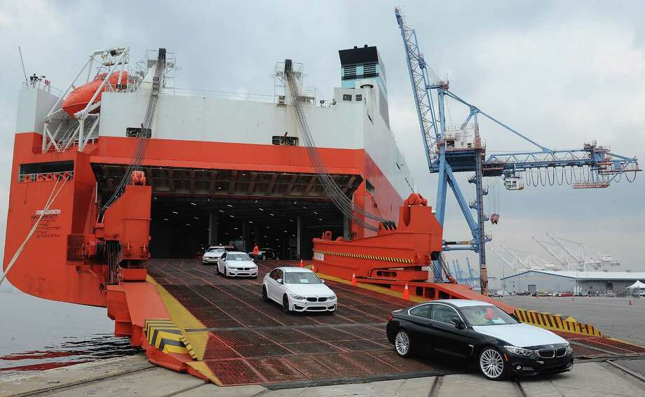 Cars come off a vessel in Baltimore last year during the official opening of BMW's vehicle distribution center in Baltimore. BMW Group broke ground Tuesday on a facility in Galveston. Photo: BMW Group, Stringer / 2014 Getty Images