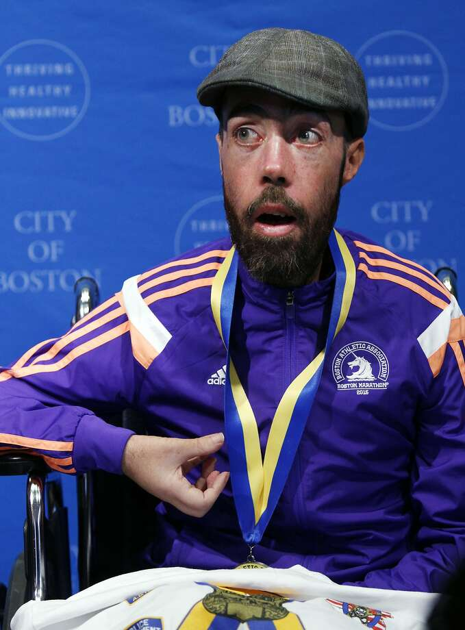 Maickel Melamed, of Venezuela, the last participant to finish this year's Boston Marathon, speaks after receiving a medal from Boston Mayor Marty Walsh during a ceremony, Tuesday, April 21, 2015, in Boston. Melamed, 39, has a form of muscular dystrophy which severely impairs his mobility. He crossed the finish line about 20 hours after he started. (AP Photo/Bill Sikes) Photo: Bill Sikes, Associated Press