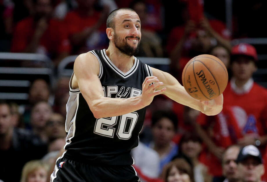 Spurs guard Manu Ginobili passes against the Clippers during the second half of Game 1 in Los Angeles on April 19, 2015. Photo: Chris Carlson /Associated Press / AP