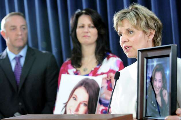 Deb Jerdo of Saranac Lake, right, holds a picture of her daughter Lindsay Jerdo, who died at the age of 18 from meningitis, on Tuesday, April 21, 2015, at the Legislative Office Building in Albany, N.Y. Joining her are Michael LaForgia of Smithtown, left, who contracted meningitis at the age of 39, and Patti Wukovitz of Long Island. She holds a picture of her daughter Kimberly Coffey, who died at 17 from meningitis. (Cindy Schultz / Times Union) Photo: Cindy Schultz / 00031542A