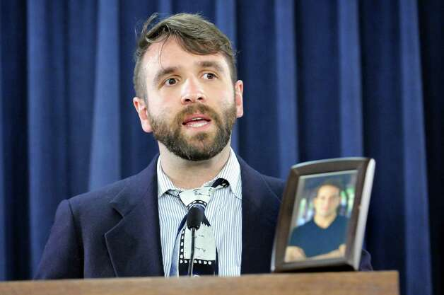 Kevin Cummines of Jersey City, N.J. has a picture of his partner Kyle Spidle, who died of meningitis at the age of 32, during a news conference on Tuesday, April 21, 2015, at the Legislative Office Building in Albany, N.Y. (Cindy Schultz / Times Union) Photo: Cindy Schultz / 00031542A
