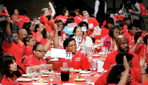 Members of the New York State Nurses Assoc. cheer during a rally to advocate for patients' healthcare needs on Tuesday, April 21, 2015, at the Empire State Plaza Convention Center in Albany, N.Y. (Cindy Schultz / Times Union) Photo: Cindy Schultz / 00031541A