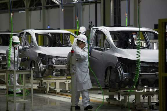Workers build Honda Fit vehicles on the production line after the opening ceremony for Honda Motor Co.'s new plant in Celaya, Mexico, on Friday, Feb. 21, 2014. Honda Motor Co., following record auto production in North America, opened its seventh auto-assembly plant as the Japanese carmaker seeks to boost sales in the region with locally sourced vehicles. Photographer: Susana Gonzalez/Bloomberg