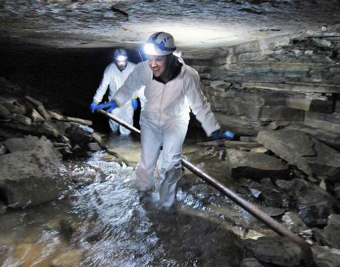 Schoharie Co. tourism coordinator Becky Stark, center, takes part in an advance tour of Howe Caverns