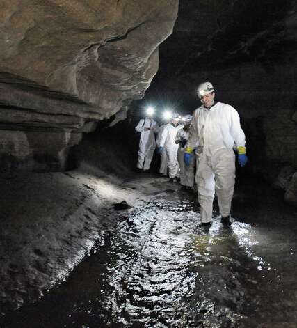 Tour manager Guy Schiavone leads an advance group into Howe Caverns soon to open Signature Rock Discovery Tour to areas of the cave not seen by the public in over 100 years during media day Tuesday April 21, 2015 in Howes Cave, NY.   (John Carl D'Annibale / Times Union) Photo: John Carl D'Annibale / 00031375A