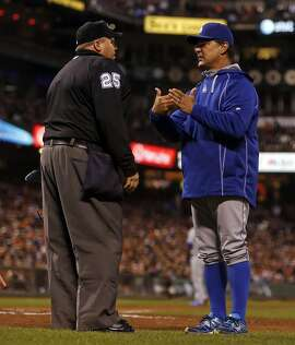 Los Angeles Dodgers' manager Don Mattingly discusses a call by umpire Fieldin Culbreth in 3rd inning during MLB game at AT&T Park in San Francisco, Calif., on Tuesday, April 21, 2015.
