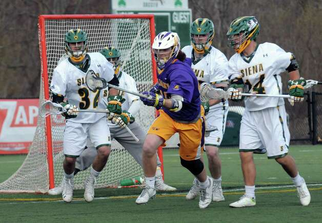 UAlbany's Kyle McClancy positions himself for a score during their men's college lacrosse game against Siena on Tuesday April 21, 2015 in Loudonville, N.Y. (Michael P. Farrell/Times Union) Photo: Michael P. Farrell / 00031539A
