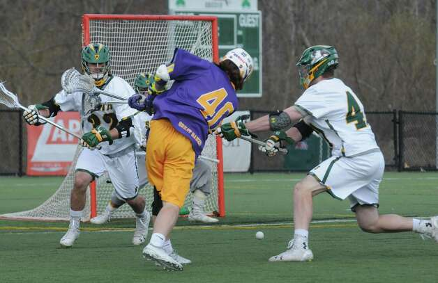 UAlbany's Kyle McClancy shoots and scores during their men's college lacrosse game against Siena on Tuesday April 21, 2015 in Loudonville, N.Y. (Michael P. Farrell/Times Union) Photo: Michael P. Farrell / 00031539A