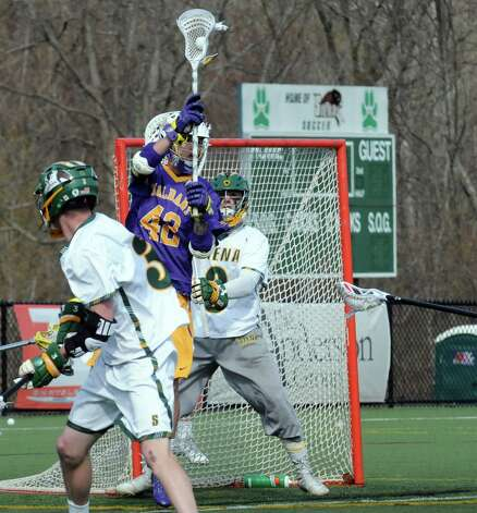 UAlbany's Kt Tarbell positions himself in front of Siena's goal during their men's college lacrosse on Tuesday April 21, 2015 in Loudonville, N.Y. (Michael P. Farrell/Times Union) Photo: Michael P. Farrell / 00031539A