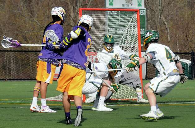 UAlbany's Seth Oakes shoots and scores during their men's college lacrosse game against Siena on Tuesday April 21, 2015 in Loudonville, N.Y. (Michael P. Farrell/Times Union) Photo: Michael P. Farrell / 00031539A