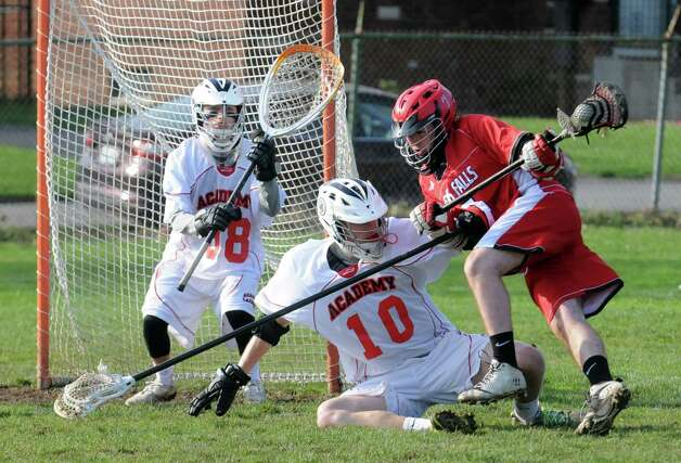 Albany Academy's Keif Manuel, 10, defends Glens Falls Chris Haas during their boys' lacrosse game on Tuesday April 21, 2015 in Albany, N.Y. (Michael P. Farrell/Times Union) Photo: Michael P. Farrell / 00031528A