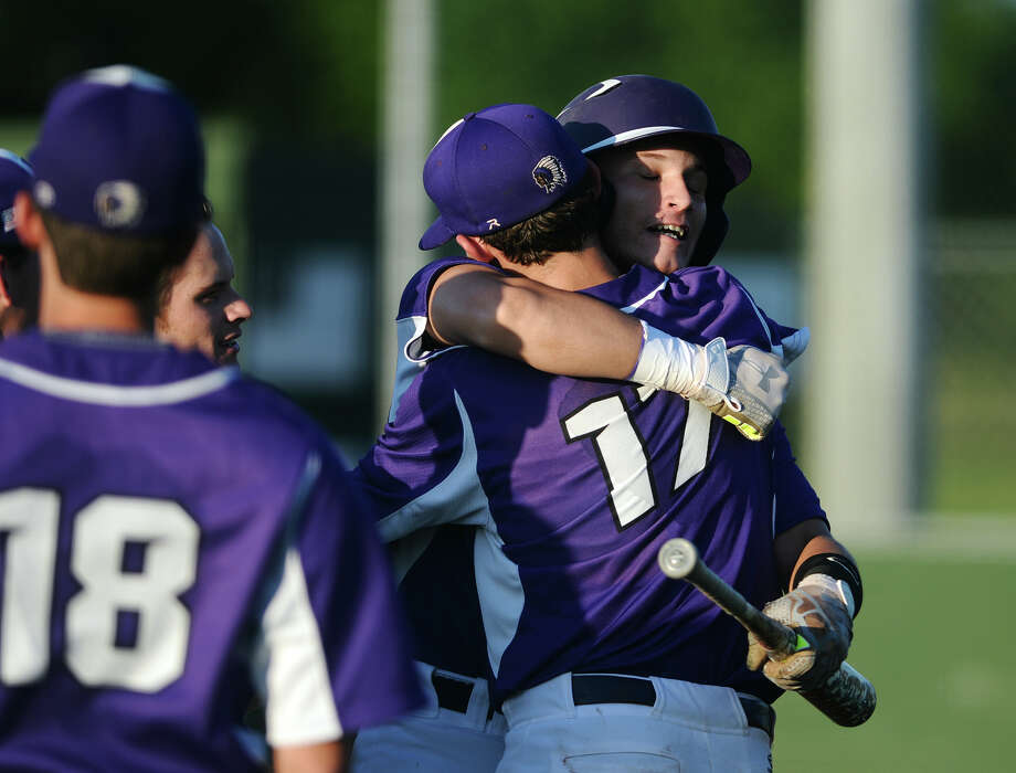 Port Neches-Groves' Blake Lane, No. 12, celebrates his home run with teammate Carter Henry, No. 17, during Tuesday's game against Nederland. The Port Neches-Groves Indians hosted the Nederland Bulldogs in a first place showdown for District 22-5A on Tuesday. Photo taken Tuesday 4/21/15 Jake Daniels/The Enterprise Photo: Jake Daniels / ©2015 The Beaumont Enterprise/Jake Daniels