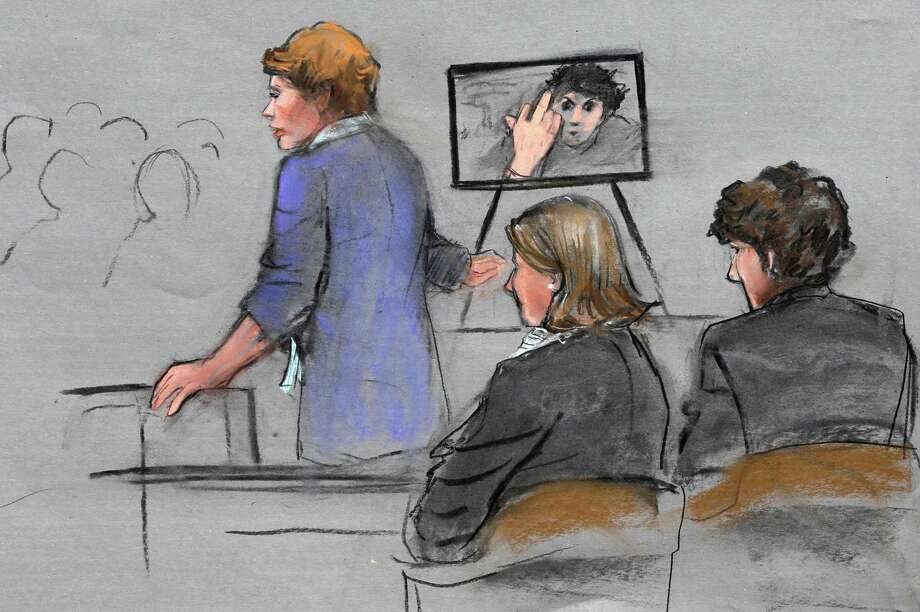 A courtroom sketch shows prosecutor Nadine Pellegrini displaying a photo of Dzhokhar Tsarnaev extending his middle finger to a security camera in his jail cell three months after the Boston Marathon bombing. Photo: Jane Flavell Collins /Associated Press / Jane Flavell Collins