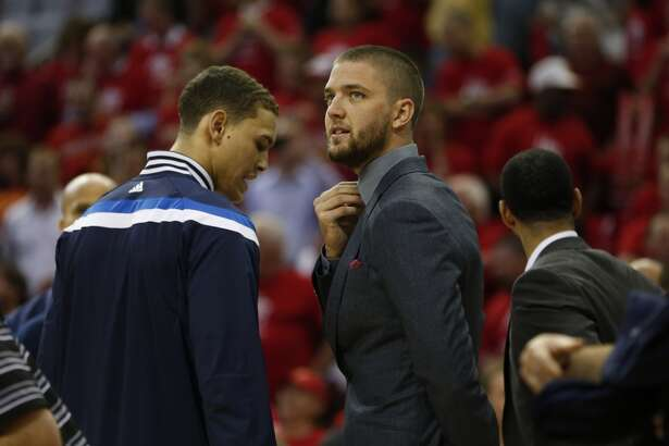 Dallas Mavericks Chandler Parsons wears a suit as he is possibly out for this series with a knee injury in the first half of Game 2 in the first round of the NBA basketball playoffs at the Toyota Center on Tuesday, April 21, 2015, in Houston.  ( Karen Warren / Houston Chronicle  )