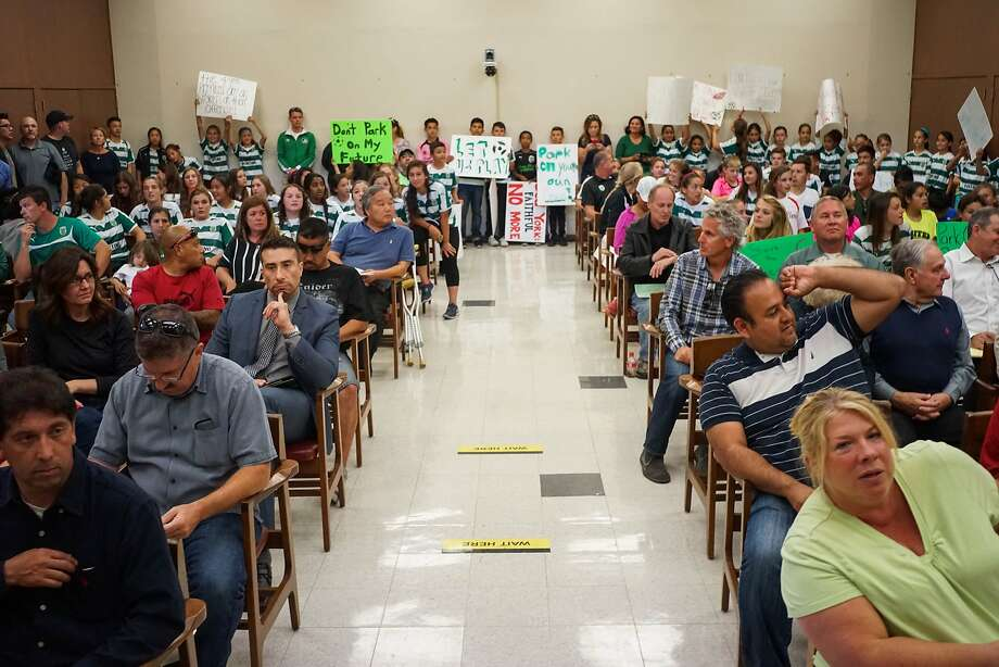 Santa Clara City Hall is packed with attendees to hear about the fate of a community soccer field near Levi's Stadium on Tuesday, April 21, 2015 in Santa Clara, Calif. Soccer fans and community members rallied together to speak their mind about the 49ers potentially turning a community soccer field into a parking lot for the Levi's Stadium. Photo: James Tensuan, SFC