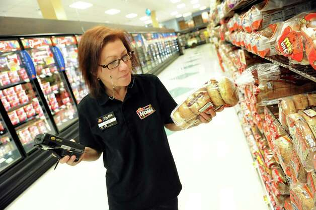 Phyllis Bloodstein, shop from home clerk, shops in the bread aisle for a customer on Tuesday, March 24, 2015, at ShopRite in Slingerlands, N.Y.  (Cindy Schultz / Times Union) Photo: Cindy Schultz/518Life / 00031128A