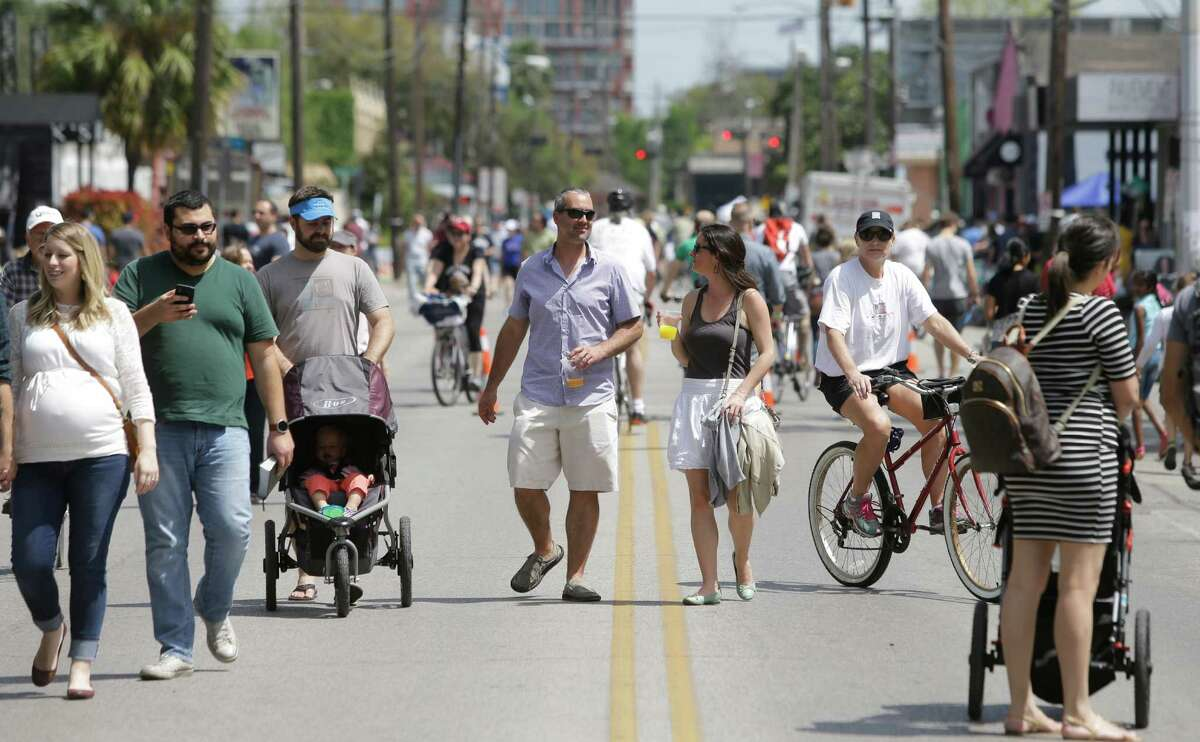 People are shown along Westheimer during the Cigna Sunday Streets Sunday in March. Part bike tour, part walking tour, part block party, Cigna Sunday Streets was created to promote and improve the health of Houstonians